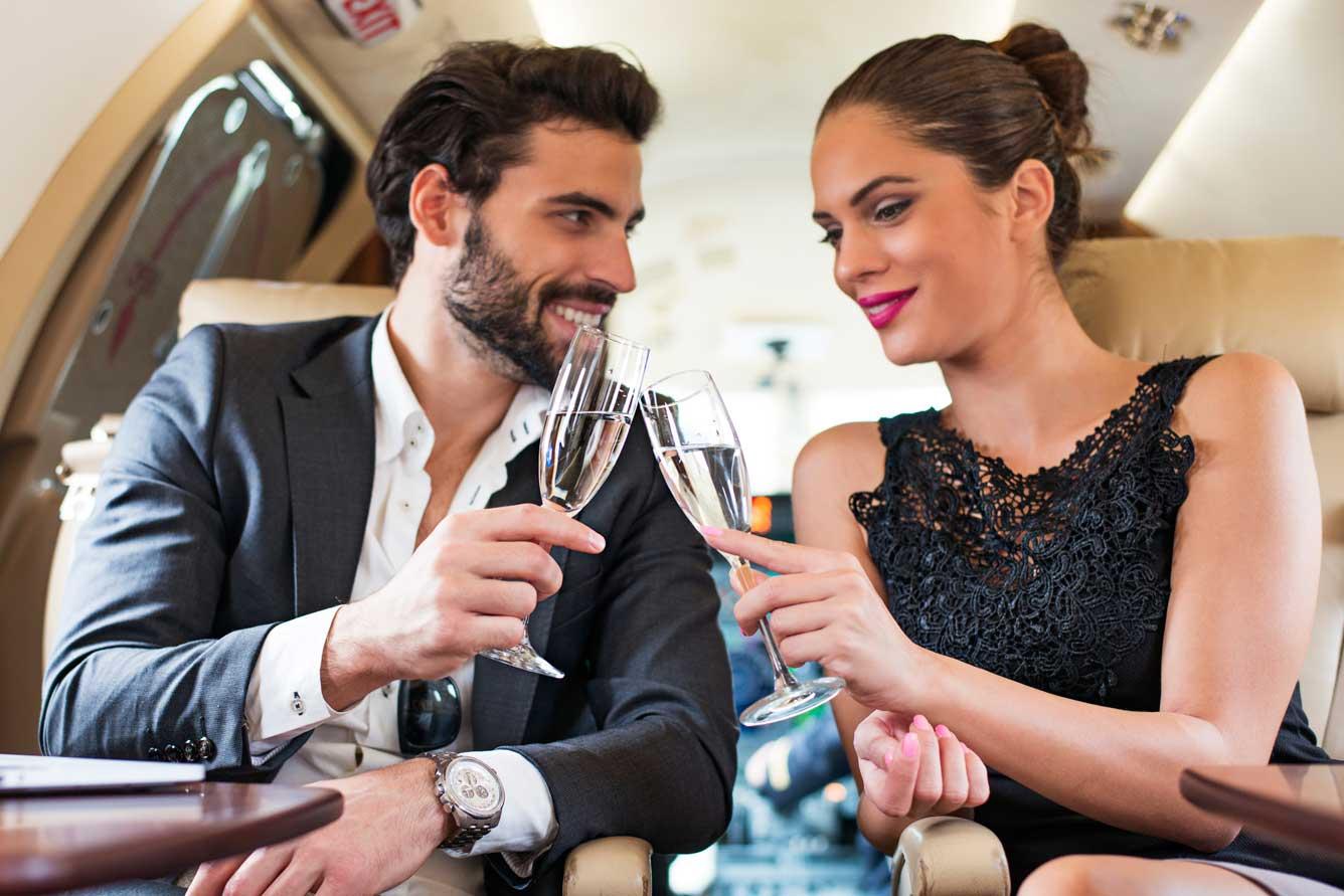 wealthy people on a jet